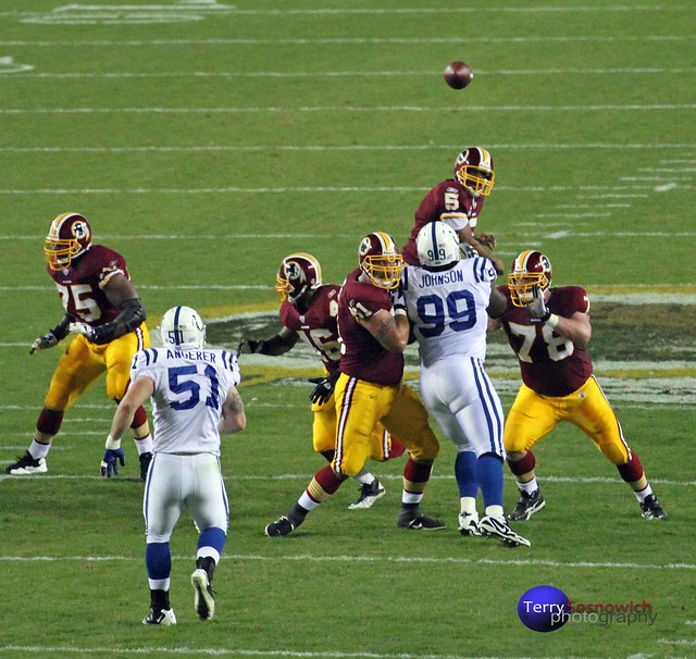 Redskins QB DONOVAN MCNABB throws down the field.