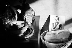 holy light (omoo) Tags: newyorkcity bw sunlight art apartment buddha westvillage altar antiques meditation dalailama greenwichvillage holylight bwphotograph privatealtar dscn3275 buddhaandthedalailama