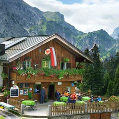 Braukunst auf hchster stufe (Bn) Tags: park blue trees summer lake mountains alps nature water car swimming bench restaurant austria tirol oostenrijk sterreich am topf50 colorful sailing place hiking turquoise altitude seat exploring meadow trails scuba diving cable hike steam deer alpine observe eben vista alm locomotive steamboat areas paragliding thealps seating tours larch viewpoint tyrol marmots protected valleys ibex pristine achensee karwendel hares chamois pertisau achen jenbach 50faves zwlferkopf 2749m achenmeer barenbadalm barenbad