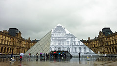 The Louvre pyramid starts to disappear, sort of (Monceau) Tags: pictures art rain architecture clouds dark different pyramid louvre contemporary workinprogress jr installation surprise 116 2016 disappearing 116picturesin2016 64undertheweather