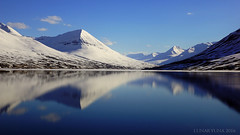 what is real anyway? ... (lunaryuna) Tags: panorama snow mountains ice water sunshine reflections season landscape iceland solitude fjord lunaryuna stillness seeingdouble earlyspring olafsfjordur northiceland northfjords northernmirrorworlds seasonalwonders stillinthegripofwinter