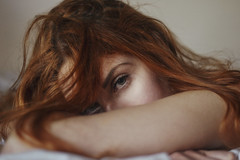 Used to dream without ever wake up (Enrico Cavallarin) Tags: morning sleeping red portrait people woman white girl face hair 50mm bed eyes soft bokeh body dream dreaming portraiture emotional delicate redhair glance ritratto laying