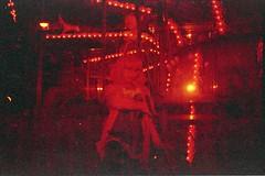 (bensn) Tags: red film night rollei dark lights pentax cosplay flash carousel limited fa multiexposure redbird mzs f19 43mm