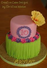 Luau cake for ICING SMILES (Christina's Dessertery) Tags: birthday pink flower green girl cake purple hula hibiscus luau lime grassskirt franjipani fondant gumpaste christinajohnson creativecakedesigns icingsmiles