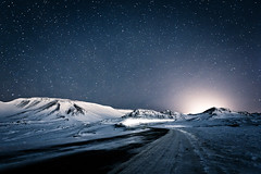 Winter Night In Iceland (KristjnFreyr) Tags: road blue light white mountain snow cold car night canon dark stars landscape star iceland europe explore blfjll sland landslag