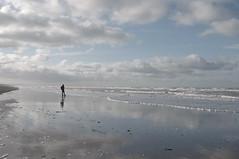 Soi. (Josephine Heather) Tags: sea sky mer france beach water mirror soleil sand eau solitude loneliness pentax stones north sable pebbles ciel shore kr miroir plage nord picardie cailloux galets cayeux rflex