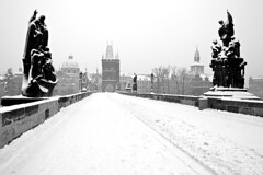 Charles Bridge in winter / Karlv most v zim (Jirka Chomat) Tags: city bridge winter blackandwhite snow tower church silhouette statue sunrise francis czech prague prag praha most czechrepublic silueta charlesbridge zima bohemia kostel karlvmost inthemorning msto socha frantiek snh svtn rno v ernobl towntower mstskv