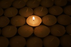 Cue Peter, Paul and Mary (betsyblue) Tags: light dark glow candle rows