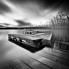 Silent Night.. (Peter Levi) Tags: longexposure sea sky blackandwhite bw blancoynegro water clouds pier boat sweden stockholm 110 le nd wreck blackwhitephotos travellingclouds bestcapturesaoi elitegalleryaoi