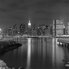 Empire State Building/Reflection from Long Island City (Shawn Hoke) Tags: nyc longexposure 120 film mediumformat cityscape manhattan lic empirestatebuilding longislandcity xtol11 hasselblad501cm zeissplanar80mmf28 fujineopanacros100 manhattanskylineatnight epsonv500 xtoldeveloper shawnhoke bwfp believeinfilm nprfilm