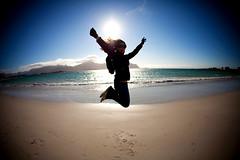 Ramberg Beach (Mel Toledo) Tags: blue sea woman selfportrait green praia beach girl silhouette norway islands mar norge jumping sand pessoa europa europe areia mulher autoretrato fisheye arctic noruega scandinavia lofoten 15mm pular ilhas silhueta rtico olhodepeixe 2011 escandinvia