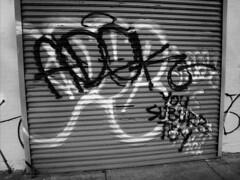 "Adek ""You Suburb Toy"" (over Mobster) (mike ion) Tags: nyc newyorkcity ny newyork brooklyn graffiti blackwhite beef tag shutter hollow throw mobstergk gkvsbtm adekbtmal3aktko"