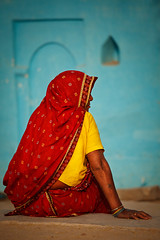 Woman in Khajuraho village. Madhya Pradesh, India (Dmitry Rukhlenko Travel Photography) Tags: red woman india color colour building home fashion architecture female rural person clothing asia sitting feminine structures architectural clothes human sit residence saree sari humanbeing humans apparel khajuraho humanbeings womensclothing attire madhyapradesh residentialbuilding ruralhome womensapparel