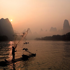 Fishing at dawn (Explored) (xiaomeisun ()) Tags: china travel sunrise landscape dawn liriver fisherman accepted1of100 ostrellina absolutegoldenmasterpiece imagicland xiaomeisun asquaresuperstarstemple flickrstruereflectionexcellence trueexcellence1 ayrphotoscontestseaandsun