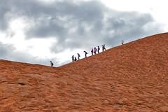 Passing on Uluru (wawrus) Tags: world red people heritage feet rock zeiss site sandstone rocks desert nt centre australia center unesco erosion formation climbing sacred uluru aboriginal northern ayers monolith scar slope territory 447 inselberg planart1450 zf2 ulara scarofuluru