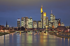 Frankfurt Skyline (Philipp Klinger Photography) Tags: longexposure bridge blue trees light urban orange reflection tree water yellow skyline architecture night skyscraper canon reflections river