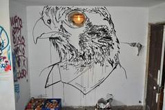 With an eagle's eye (id-iom) Tags: street uk light urban black bird london eye art wall shirt studio graffiti eagle vandalism drips collar brixton idiom