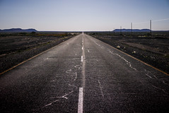 Endless road (Marc Heurtaut) Tags: africa composition dark landscape lumix vanishingpoint rocks horizon wideangle bluesky na panasonic curve asphalt namibia karas yellowline namibie lx100 dryherbs