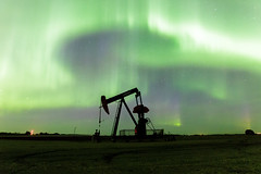 Oilpatch Light Show II [Explored] (Blue Trail Photography) Tags: light sky canada night jack lights grande outdoor north pump alberta aurora oil prairie patch northern oilfield borealis pumpjack oilpatch