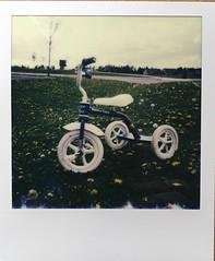 Little Tike (ildikoannable) Tags: film bike vintage polaroid tricycle kidsbike impossiblefilm