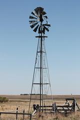 Seen Better Days (susan_copley) Tags: windmill alberta prairies fenceline