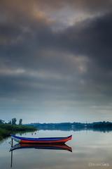 A Window in the Sky (Alejandro Garca Seplveda) Tags: sol portugal azul agua barca reflejos aveiro torreira nuebes