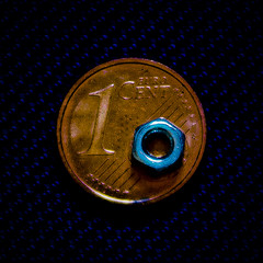 A small nut over a small coin (Ignacio M. Jimnez) Tags: coin small nut pequeo moneda tuerca macromondays smallerthanacoin