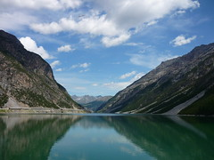 Reflections (SixthIllusion) Tags: travel italy panorama lake mountains nature water reflections livigno