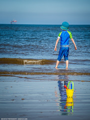 Outward looking (Ian Betley Photography) Tags: blue boy sea sky sun beach water hat swimming seaside bucket sand waves quote ripple tide horizon son lancashire rig oil distance ainsdale southport oilrig spade perpective