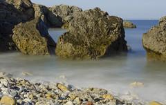 Rocks (Preston Ashton) Tags: ocean longexposure sea sun beach water sunshine rock boat day ship sunny pebbles boulder pebble le sail prestonashton