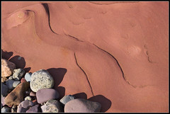 Pebbles on Sandstone (ShinyPhotoScotland) Tags: colour art nature closeup scotland places pebble gb brodick arran oldredsandstone rockstone rawconversion rawtherapee