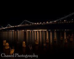 Bay Bridge Night Life v3 (ChasedPhotography) Tags: ocean california longexposure bridge water night lights bay pier baybridge embarcadero bayarea sfbayarea sffd suspensionbridge fireboat sanfransisco