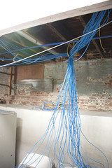 Blue noodles? (EyePulp) Tags: brick illinois construction unitedstates interior object plumbing insulation location structure manmade framing electrical studs 2x4 lumber remodeling naturalgas towanda gaspipe churchhome closedcellfoam
