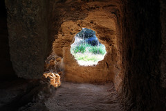 Tomb of Kings ..Cyprus (Don Jackson) Tags: light window rock landscape moody atmosphere caves tombs natureshadow