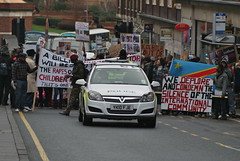 West Yorkshire Police Vauxhall Astra leads protesters in Leeds City Centre. (EYBusman) Tags: city west car gm panda yorkshire centre leeds police demonstration cruiser patrol protesters astra headrow opel vauxhall eybusman