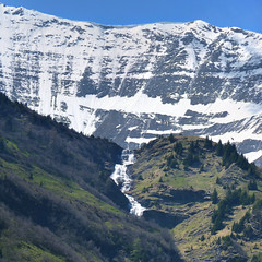The melt water falls over the Alpine ridge (Bn) Tags: road blue sun snow moun