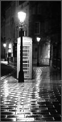 timeless (kimbenson45) Tags: street light blackandwhite bw reflection wet rain night booth reflecting mono evening box streetlamps streetlights pavement telephone cobblestones sidewalk oxford paving cobbles