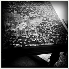 Progress (intuned_gato) Tags: blackandwhite missing 2000 pieces puzzle match jigsaw piece iphone makingthepiecesfit hipstamatic
