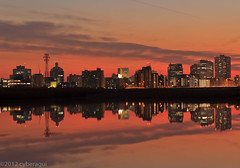 City on Fire (Cyberagui's Gallery) Tags: lighting city sunset reflection building river eveningglow flickrbronze