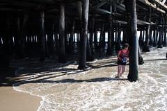 Self under Santa Monica Pier (spastic.hero) Tags: california summer usa sun colour beach water girl photography pier sand santamonica j1