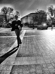 Late for an Important Date (Eric Spiegel) Tags: street camera city shadow urban blackandwhite man lines washingtondc dc washington streetphotography running dcist iphone iphoneography cameraplus instantdc