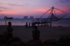 Fort Kochin sunset - with Chinese Fishing Nets (rosiemrogers) Tags: pink light sunset red sea sky india colour beach silhouette yellow night canon landscape evening fishing dusk goa kerala nets fortkochin