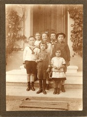 Children on a doorstep (undated) (pellethepoet) Tags: door girls friends portrait boys hat fashion kids children steps kinder photograph suspenders groupportrait doormat mdchen doorstep jungs jungen sailorsuit cabinetcard knaben