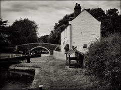 Old hill bridge No 107 Staffs & Worcs canal (lovestruck.) Tags: uk bridge summer england reflection water geotagged canal blackwhite lock cottage steps monotone 2011 staffsworcscanal geo:lat=5279477676837303 geo:lon=20341782912597637