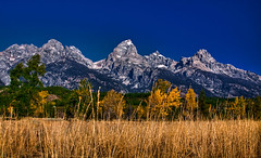 John D. Rockefeller, Jr. Memorial Parkway, The Tetons (MALALINA43) Tags: blue sky snow mountains fall clouds forest photoshop canon rockies parks grand wyoming teton nationalparks hdr lightroom rockiemountains grandtetonnationalpark photomatix 24105mm