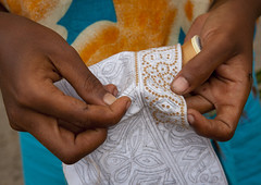 Woman Sewing A Kofia, Lamu, Kenya (Eric Lafforgue) Tags: africa color hat horizontal closeup outdoors island photography concentration hands exterior hand kenya sewing muslim islam culture unescoworldheritagesite afrika tradition lamu patience swahili afrique eastafrica thoroughness qunia humanhand kofia lamuisland lafforgue traveldestination africanethnicity  qunia meticulousness    kea   tradingroute 159795 blackethnicity a