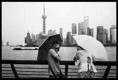 . (tany_kely) Tags: china street leica urban blackandwhite bw woman white man black rain umbrella river couple noir shanghai noiretblanc femme riviere pluie nb lovers rue blanc chine homme amoureux parapluie urbain m9