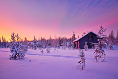 Under a fiery sky (Thierry Hennet) Tags: morning blue winter orange house snow tree zeiss landscape dawn frozen finnland sony scenic magenta lapland cloudysky kslompolo a900 coldtemperature cz1635mmf28
