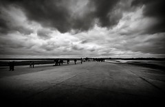 The Tourists have Landed! (Missy Jussy) Tags: road trip travel sky people bw france tourism monochrome clouds canon landscape mono blackwhite horizon tourists walkways tamron normandy lemontsaintmichel moodylandscape tamron1024mm cannon600d