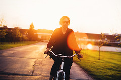 Sunset (Gabriela Tulian) Tags: life autumn sunset portrait people sunlight brick beautiful smiling bike bicycle relax fun outdoors one cycling spring cool pretty day adult candid free lifestyle charm identity biking backpack attractive commuter casual copyspace brunette activity caucasian individuality